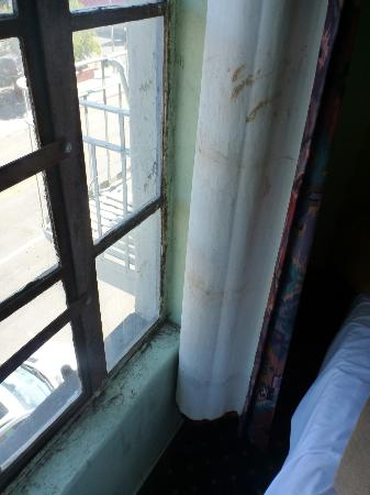 Travelers Hotel: window and stained curtains
