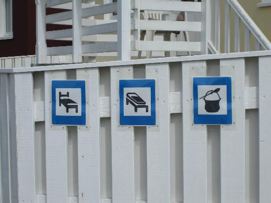 The Little Guesthouse by the Ocean : Signage for the Guesthouse on the fence