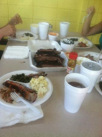 UNCLE RODNEY'S RIBHOUSE: Table Full of Food