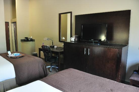 Best Western Plus Texoma Hotel & Suites: Entertainment dresser, desk, mirror and coffee stand