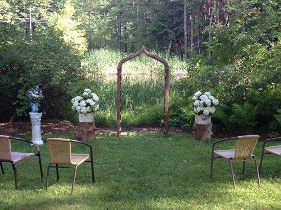 The Inn at Weathersfield: ceremony by the pond