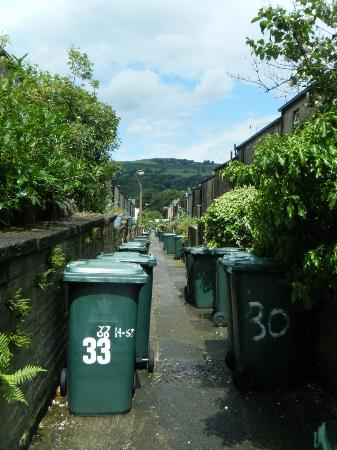 Saltaire Village: The alleyway between two rows of houses to hide away the bins, and washing lines.