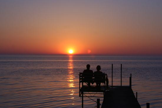 Shallows Resort: couple sharing sunset on the pier