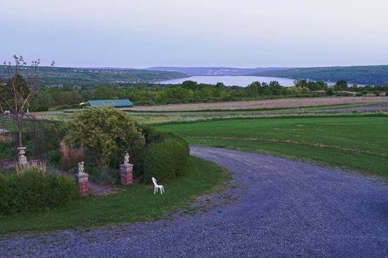 The Lakefront Inn: View from the deck/balcony at dusk. You can see Ithaca College on the far side of the lake!