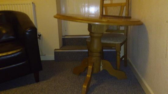 The Beeches Apartments: Table leant against a wall to hide a broken leg.