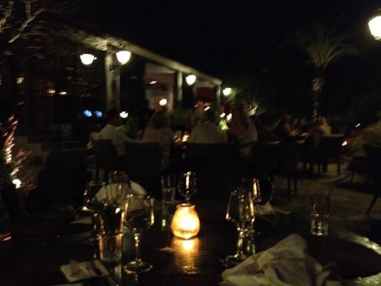 Parrilla Natural : dining area at night.