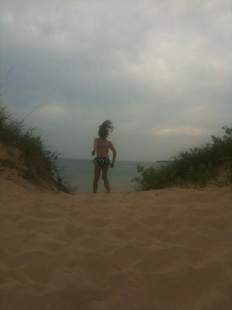 Petoskey State Park: jumping off the dunes toward the beach