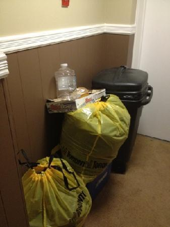 Victoria's Mansion Guest House: Trash like this was stacked up outside our door every day.