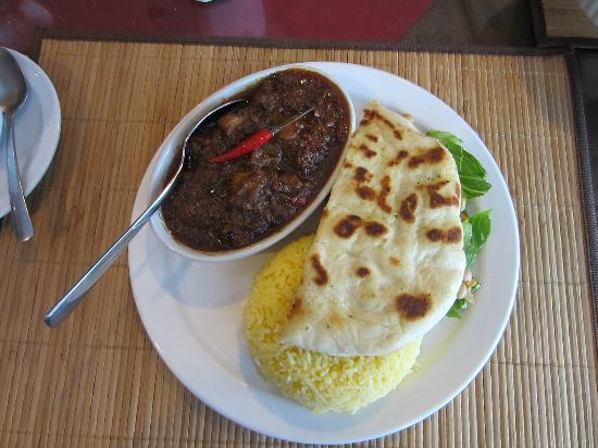Dhaba Express: Beef vindaloo combination plate - curry, rice, nan bread & salad.