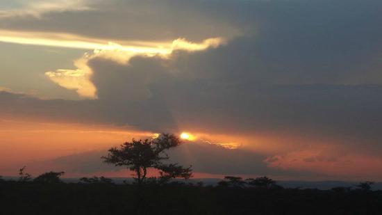 Encounter Mara, Asilia Africa: gorgeous sunset across Naboisho Conservancy