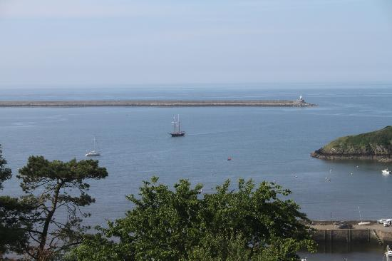 Pentower: Beautiful view across the bay with a twin masteed sail boat in the middle-ground