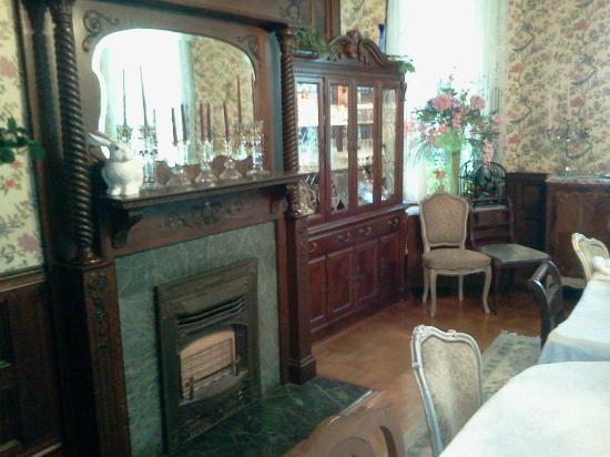 Mistletoe Bough Bed and Breakfast: Fireplace and hutch in dining room