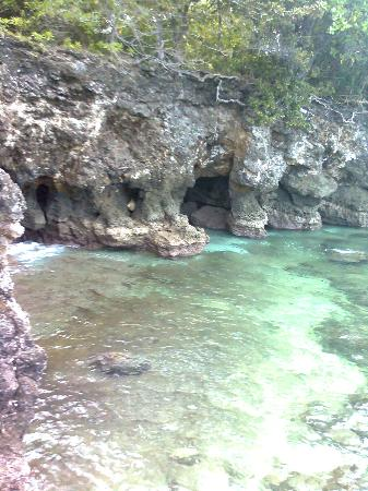 Sarangani Island: cave formed by the water...