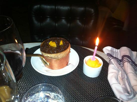 Beefbar Monaco: Chocolate and orange souffle with birthday candle
