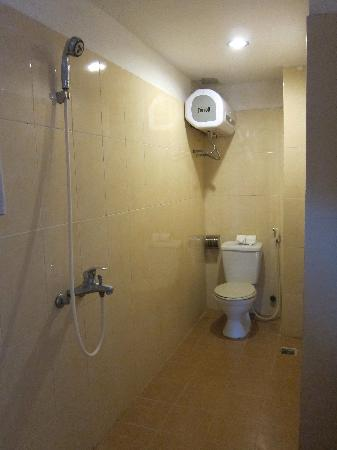 New Century Hotel: Wet room shower/toilet.