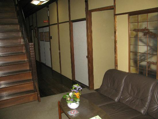 Aikume Ryokan: Hall and stairs to rooms.
