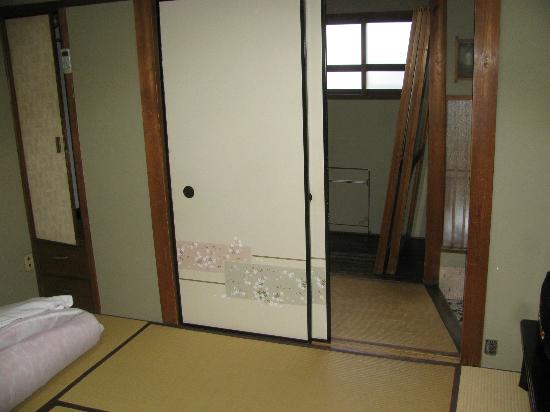 Aikume Ryokan: Inside our room (notice outlet to right of door).