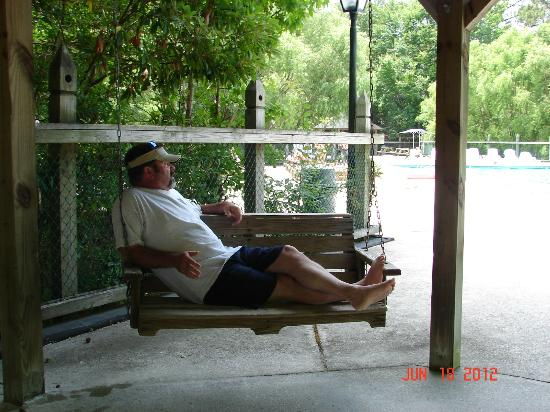 Barrier Island Station at Kitty Hawk: Porch swing near pool area
