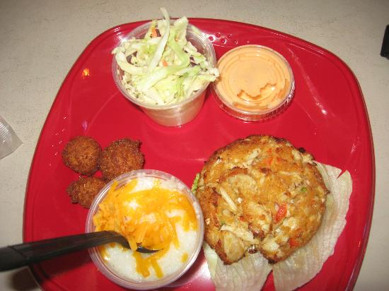 Crab cake with cheesy grits hush puppies and cole slaw for Flying fish bar and grill