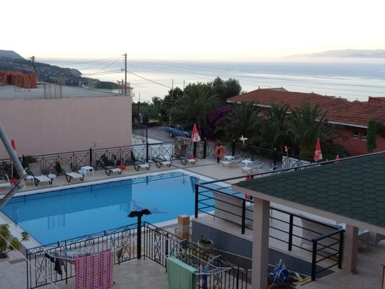 Saoulas Studios: view over the pool from balcony Room 1 , Zante in the distance