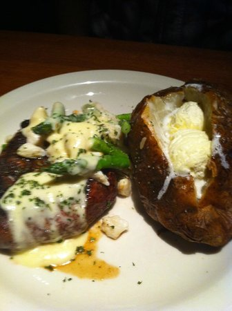 Austin's Restaurant & Bar: Filet Oscar with baked potato (smothered in butter)