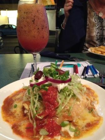 La Casita Mexicana: Chicken Enchilada Stack partnered with an orange and passionfruit mocktail.