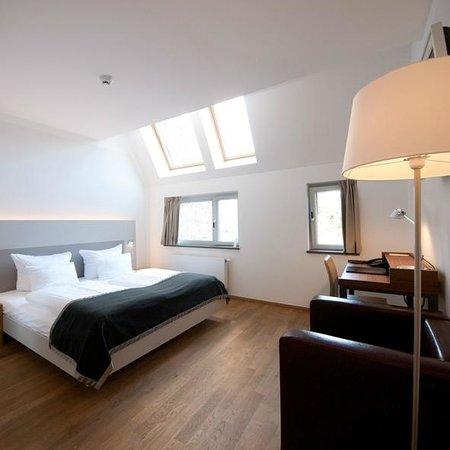 Qube Hotel Heidelberg: Unsere schönen Qube Zimmer verfügen auf Wunsch über extra lange Betten.