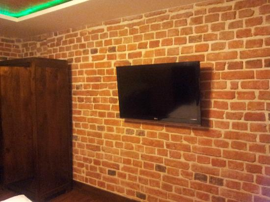 Apartamenty Torun - Strumykowa: Flat TV in bedroom