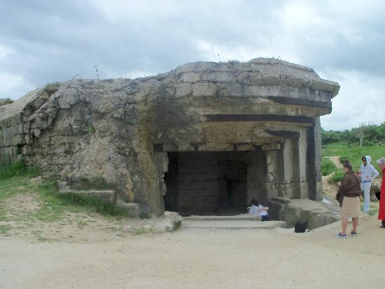 """Saint-Laurent-sur-Mer, France : one of the many """"pill boxes"""" on the beach"""
