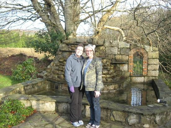Tudor Lodge : Me and my sister in front of a water feature in the rear of the lodge