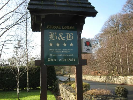 The sign welcoming those to Tudor Lodge