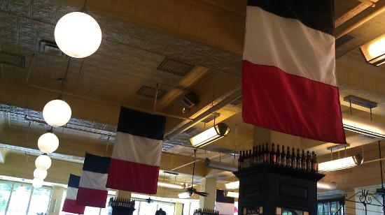 Can Can Brasserie: The flags and tin ceiling at the Can Can.