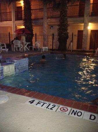 Howard Johnson Inn and Suites Central San Antonio: having fun a night swim
