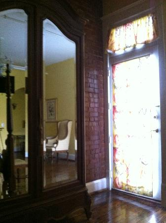 The Dwell Hotel: A view of the beautiful antique armoire and the door leading to my private balcony.