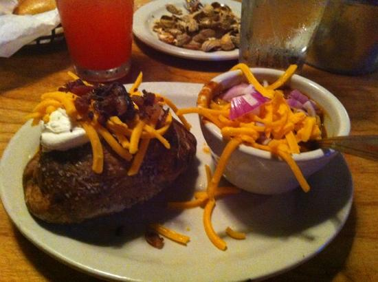 Texas Roadhouse: Loaded baked potato and a cup of chili...both side orders, delicious and very filling!
