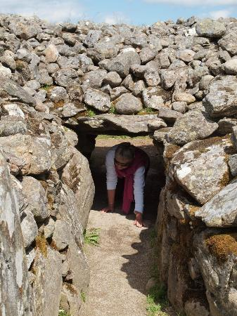 Corrimony Chambered Cairn: Crawling through the original 4,000 year old passage.