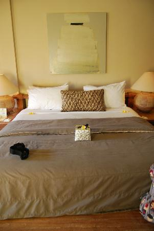 Sienna Villas: The master bedroom bed with our welcome gift in the silver box.