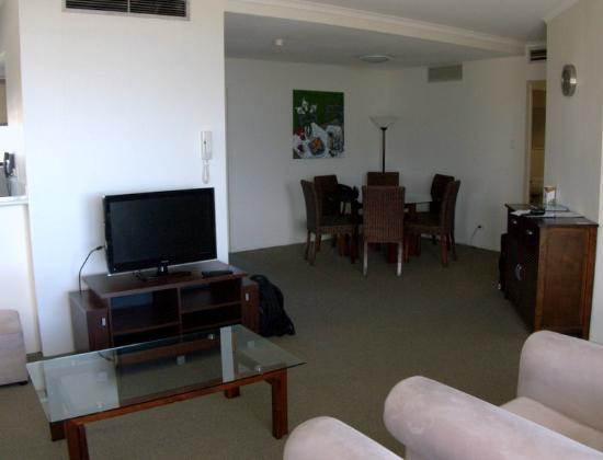 Rydges Esplanade Resort Cairns: Living and dining rooms (kitchen is to left, behind TV area)