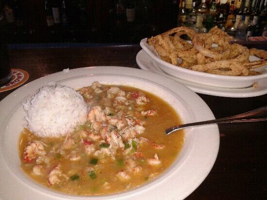 Boudreaux's Louisiana Seafood: Crawfish etoufee with onion rings!! Yummy!!