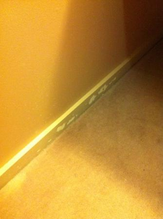 The Litchfield Inn: chipped paint on baseboard