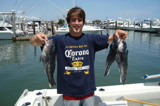 Defiant Charters Day Tours: My son holding up some of our catch
