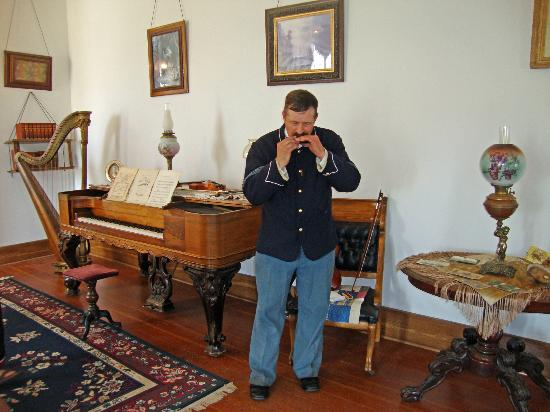 Tour Guide At Custer House Playing Harmonica Picture Of