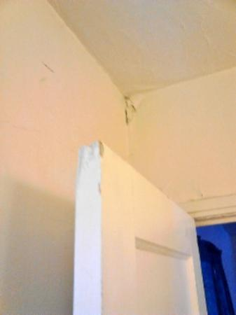 Apache Lodge: peeling paint, and the bathroom door would not close properly, warped.