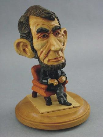 The Gallery on Sixth: Hand-carved caricature of Abe Lincoln