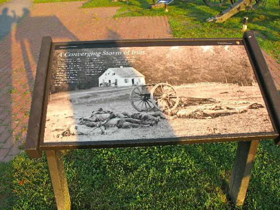 Antietam National Battlefield: Placard with pictures of church and cannons taken after the battle.