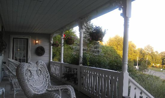 The House on the Hill: The front porch at twilight; this shows about 1/3 of the sitting area.
