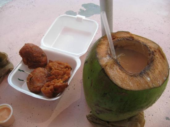 The Bahamas' Arts and Straw Market: conch fritters and a rum drink in a coconut.