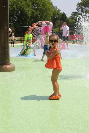 Jackson, MS: My daughter at the splash pad. Thats a little slide in the background