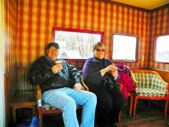 Great Smoky Mountains Railroad: the caboose front lounge area. love that wallpaper!