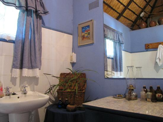Blue Cottages Country House: Bathroom was separate from room, but include huge claw foot tub!